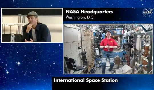 """In this image taken from NASA video actor Brad Pitt, left, star of the new space movie """"Ad Astra,"""" speaks from NASA headquarters in Washington, to astronaut Nick Hague abroad the International Space Station, on Monday, Sept. 16, 2019."""