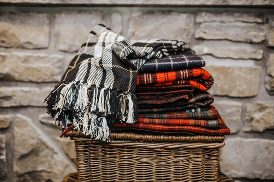 Give your guests their pick of blankets! You want visitors to be cozy and feel at home, so take some of the stress away by having comfort items within arm's reach.