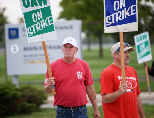 Ted Williams, 61, of Detroit, left, a 40-year GM employee, and Chuck Wise, 46, of Detroit, a 19-year employee,at the Hamtramck Assembly plant, walk the picket in front of the main entrance Monday morning.