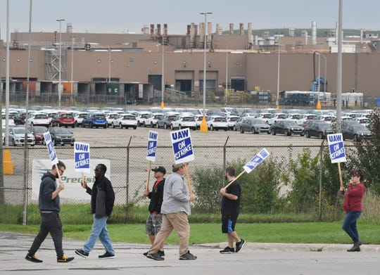 UAW workers picket on the south side of the GM Lake Orion Assembly plant in Lake Orion, Michigan, early Monday, Sept. 16, 2019.