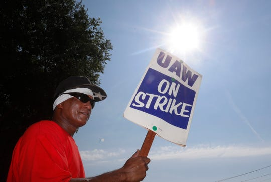 Dennis Johnson pickets outside the General Motors Plant in Arlington, Texas, Monday, Sept. 16, 2019. More than 49,000 members of the United Auto Workers walked off General Motors factory floors or set up picket lines as contract talks with the company deteriorated into a strike.