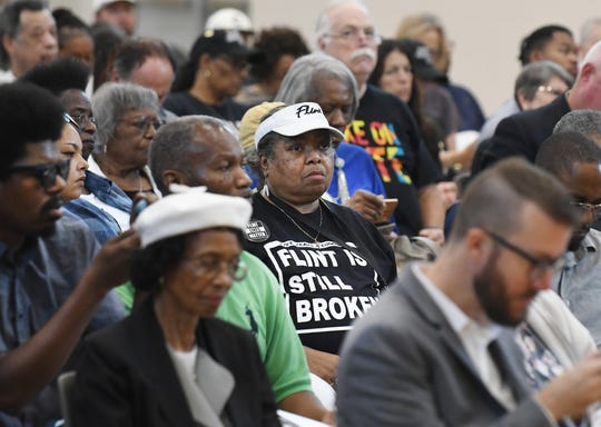 Audience members listen to speakers during a congressional hearing with U.S. Rep. Rashida Tlaib and other lawmakers regarding air and water quality in one of Detroit's most polluted zip codes.