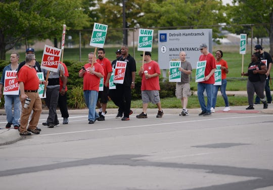 UAW workers at GM Hamtramck Assembly plant walk the picket line in front of the plant Monday morning.
