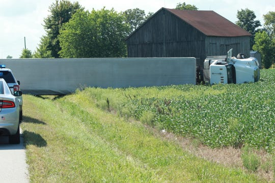 A semi overturned eastbound on U.S. 6 Monday near County Road 202. The male driver suffered minor injuries, according to Ohio Highway Patrol.