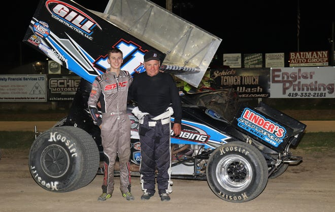 Buddy Kofoid, left, celebrates with his car owner, Ed Neumeister, after winning the 410 championship Saturday at Fremont Speedway.