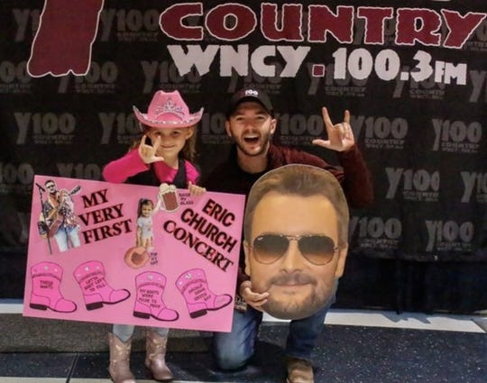 "Five-year-old Aubree Taggart, of Oshkosh, has some pre-show fun with Y100 on-air personality Kyle ""The Big"" Lewandowski before the Eric Church concert Friday night at the Resch Center. Church signed her boot during the concert."