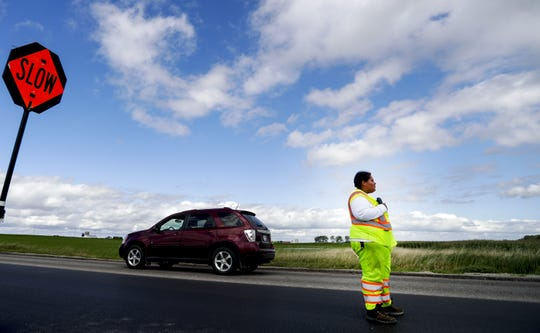 Shanta Jackson is the only African American woman in her construction crew. She is a flagger who last week helped control traffic near a road construction site on State 114 between Chilton and Sherwood.