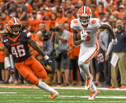 Clemson wide receiver Tee Higgins (5) runs near Syracuse senior Lakiem Williams(46) for a first down during the first quarter at the Carrier Dome in Syracuse, New York, Saturday, September 14, 2019.