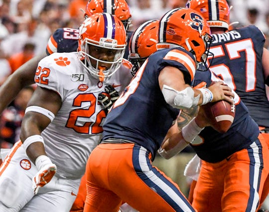 Clemson defensive end Xavier Kelly (22) pressures Syracuse sophomore Tommy DeVito(13) during the second quarter at the Carrier Dome in Syracuse, New York, Saturday, September 14, 2019.