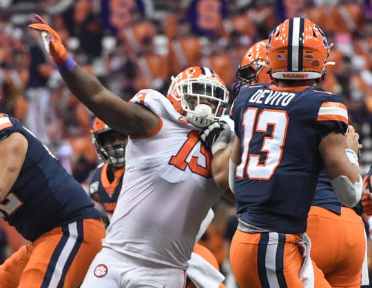 Clemson defensive lineman Tyler Davis(13) pressures Syracuse sophomore Tommy DeVito(13) during the first quarter at the Carrier Dome in Syracuse, New York, Saturday, September 14, 2019.