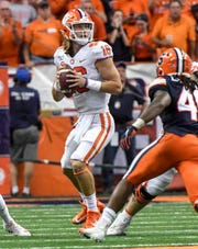 Clemson quarterback Trevor Lawrence (16) fades back to pass near \s44d\ during the first quarter at the Carrier Dome in Syracuse, New York, Saturday, September 14, 2019.