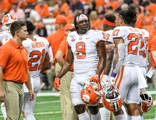 Clemson running back Travis Etienne (9) with teammates during pregame warm up before the game at the Carrier Dome in Syracuse, New York, Saturday, September 14, 2019.