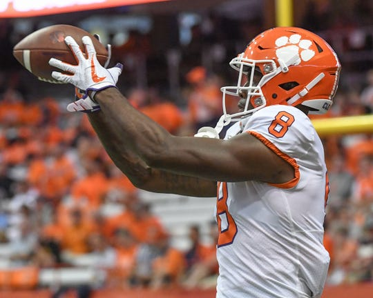 Clemson wide receiver Justyn Ross (8) catches a ball during pregame warm up before the game at the Carrier Dome in Syracuse, New York, Saturday, September 14, 2019.