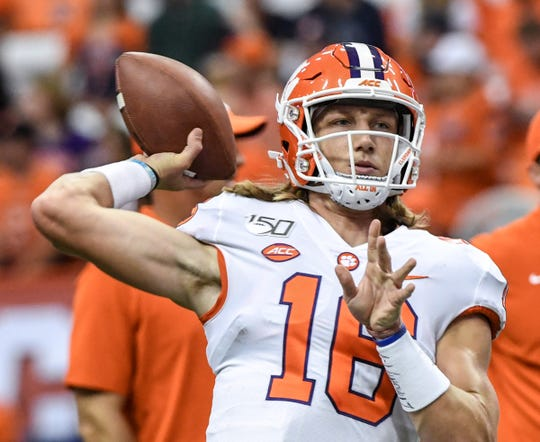 Clemson quarterback Trevor Lawrence (16) throws during pregame warm up before the game at the Carrier Dome in Syracuse, New York, Saturday, September 14, 2019.