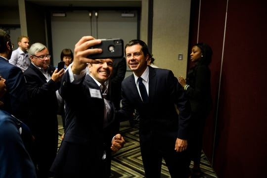 Democratic presidential candidate Pete Buttigieg takes photos with supporters after speaking at a Upstate Chamber Coalition breakfast event Monday, Sept. 16, 2019.