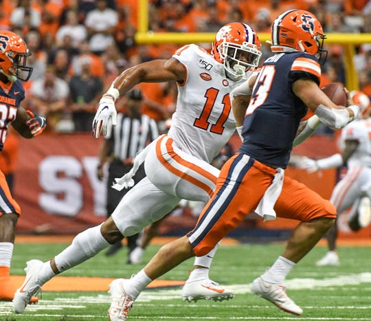 Clemson safety Isaiah Simmons (11) had two of Clemson's eight sacks of Syracuse quarterback Tommy DeVito.