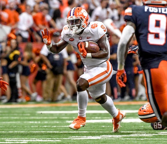 Clemson running back Travis Etienne (9) runs near Syracuse senior Evan Foster(9) during the second quarter at the Carrier Dome in Syracuse, New York, Saturday, September 14, 2019.