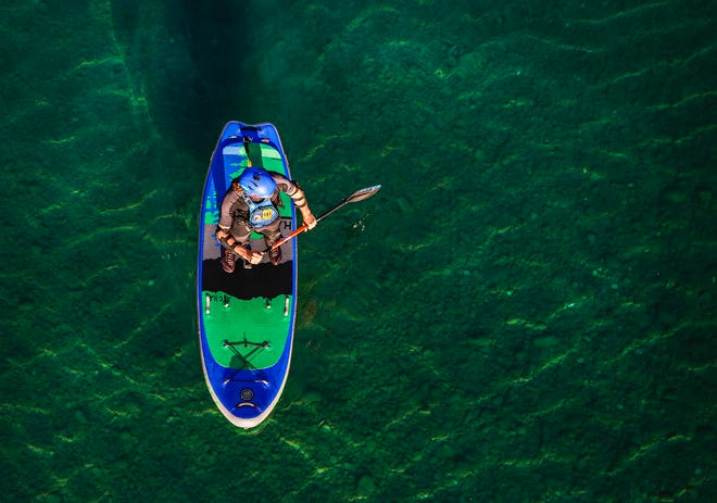 In a Sept. 5, 2019 photo,Jimmy Reed of Whitefish paddle boards on the Middle Fork of the Flathead River below Belton Bridge in West Glacier.