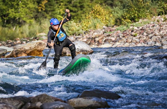 In a Sept. 5, 2019 photo, Jimmy Reed of Whitefish paddle boards through a rapid on the Middle Fork of the Flathead River near Belton Bridge in West Glacier.