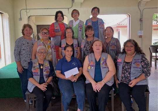 The Guam Sunshine Lions Club presented a monetary donation to help with off-island medical treatment expenses for Barbara Cepeda, 52, of Dededo, on Sept. 6. Seated from left: Lion Jovie Mejorada, Cepeda, Lion Doris Cruz, and Pres. Lorraine Rivera. Second row: Lions Sita Crisostomo, Jill Pangelinan, Dot Leon Guerrero, Mary Taitano, and Marie Salas. Back row: Lions Connie Rivera, Sid Weedin and Dee Cruz.