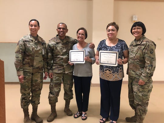 On behalf of Governor Lou Leon Guerrero and LT. Governor Joshua Tenorio, DMA Director and Senior Commander of Guam National Guard, Adjutant General Esther Aguigui presented the governor's certificate of appreciation to Julia Parnias and Charito San Agustin for their faithful service to the Government of Guam and invaluable roles to the operations of the Department of Military Affairs.  The retirement presentation took place Sept. 3 at the Guam National Guard Readiness Center in Barrigada. From left: Adjutant General Esther Aguigui; Assistant Adjutant General Kory Gacono; Julia Parinas, Administrative Services Officer; Charito San Agustin, Accounting Technician III and Command Sergeant Major Agnes Diaz.