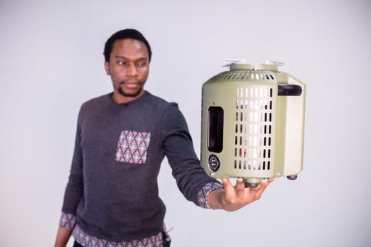 Max Chinnah holding his Genesys cooker.