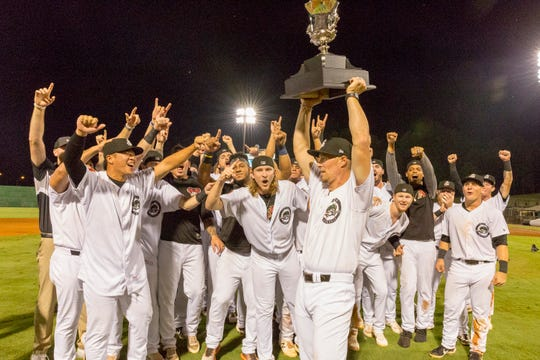 The Jackson Generals celebrate with their trophy minutes after winning the Southern League championship.