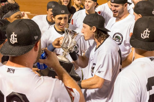 Jackson Generals players continued the tradition of drinking from the cup of the championship trophy after their win on Sunday night.