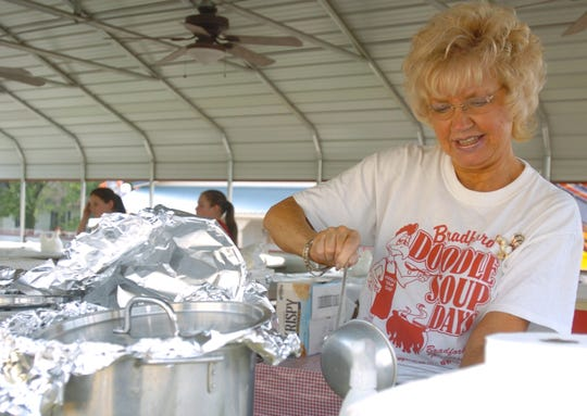 Brenda Goodman pours a cup of doodle soup on Sept. 14, 2007 during Doodle Soup Days in Bradford, Tenn.