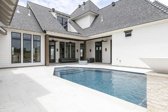 Audubon Plantation mansion in south Lafayette is on the market for $1.47 million. The home has a saltwater pool, a custom pet room with a shower and a custom indoor and outdoor pool room.