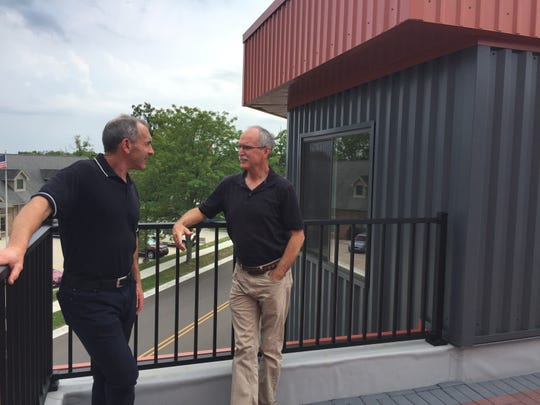 Builder Mitch Harris, left, and architect Piet Lindhout discuss the ultra-modern features of Second Street Flats in downtown Brighton from a rooftop patio, Tuesday, Sept. 10, 2019.