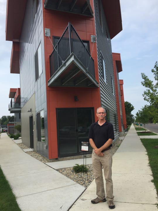 Architect Piet Lindhout stands outside new Brighton condos Second Street Flats, Tuesday, Sept. 10, 2019