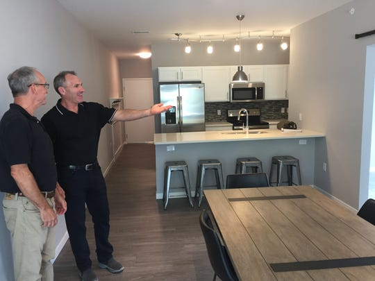 Architect Piet Lindhout, left, and home builder Mitch Harris show interior features of Second Street Flats, a new condo development in downtown Brighton, Tuesday, Sept. 10, 2019.