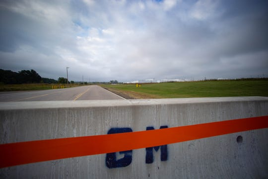 A concrete roadblock is seen blocking the road  to the entrance of the Lansing Delta Township GM plant, Monday morning, Sept. 16, 2019, the first day of a nationwide strike against GM.