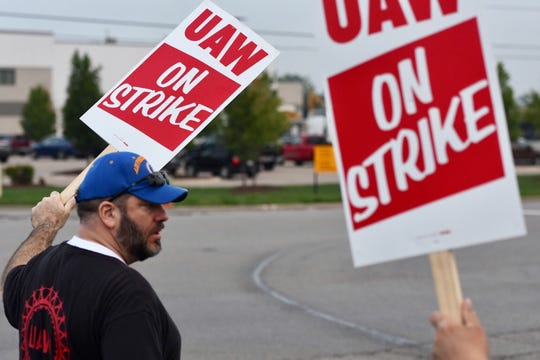 GM temp worker Herb Simpson, a member of UAW Local 602, pickets with fellow workers Monday morning, Sept. 16, 2019 near Canal Road and Millett Highway, just outside the entrance of the Lansing Delta Township plant.