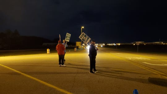 A walkout a GM's assembly plant in Delta Charter Township marked the beginning of a nationwide strike.