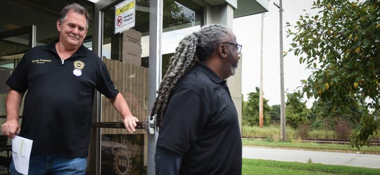 UAW Local 652 President Randy Freeman, left, and District Committee member Keith Cannon leave their Lansing Township headquarters Monday afternoon, Sept. 16, 2019, to help organize workers on the first day of the nationwide strike against General Motors.