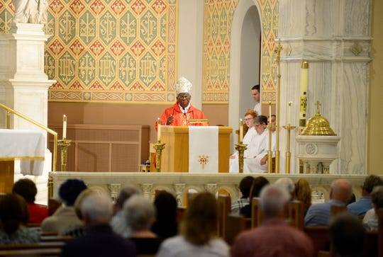Cardinal Francis Arinze, retired prefect of the Congregation for Divine Worship and Discipline of the Sacraments, presides over Mass at St. Peter's Catholic Church in Mansfield on Monday.