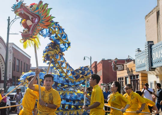 Confucius Institute dancers perform at the Memphis Chinese History & Culture Festival parade on Beale Street  in Memphis  on Sunday, Sept. 15, 2019.