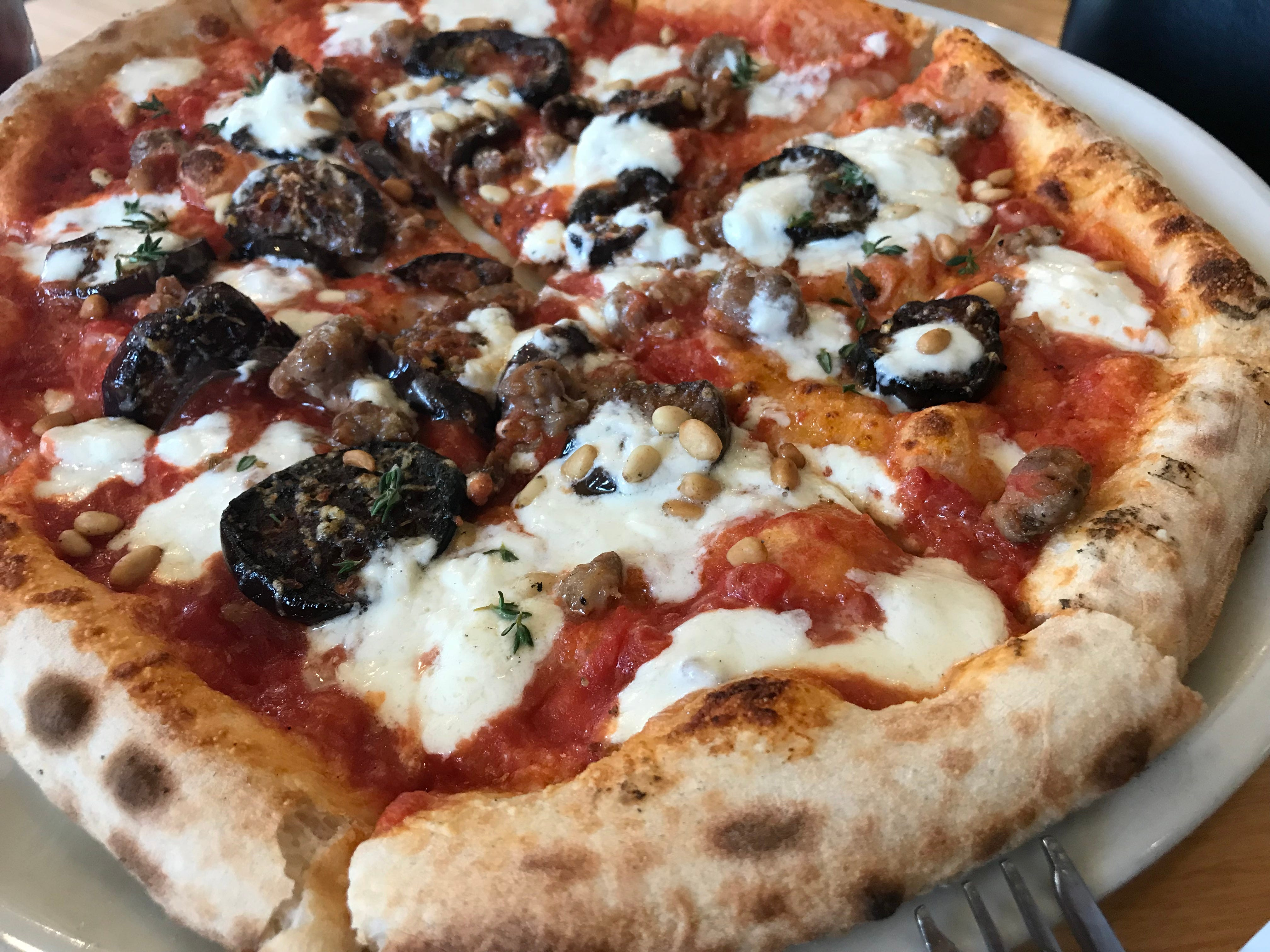 Eggplant Magic was a seasonal Neapolitan-style pizza in summer at Anodyne Coffee Bay View Cafe, 2920 S. Kinnickinnic Ave. Besides eggplant marinated to taste like caponata, it was topped with warmed burrata cheese, Italian sausage and pine nuts.