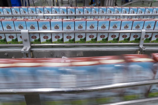Fresh milk that is shelf-stable for up to nine months is packaged at the Pakchong Dairy Cooperative in Pak Chong, Thailand.