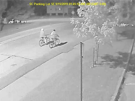 A surveillance photo shows two people involved in a fatal stabbing riding away on mountain bikes during the early morning hours Sunday, Sept. 15, in West Allis. The man and woman were last seen heading north in the 2000 block of South 71st Street.