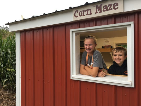 Natalie and Eli Ernst are in charge of selling corn maze tickets at their family farm, Creekside Valley Farm.