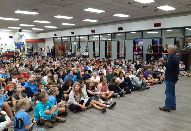 Best-selling author Mike Lupica visits with sixth-grade students at Pilgrim Park Middle School in Elm Grove Friday, Sept. 16, 2019.