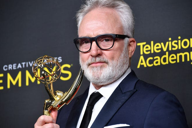 """Bradley Whitford poses with his Emmy for outstanding guest actor in a drama series Sunday night at the 2019 Creative Arts Emmy Awards in Los Angeles. Whitford took home the Emmy, his third overall, for his performance on """"The Handmaid's Tale."""""""
