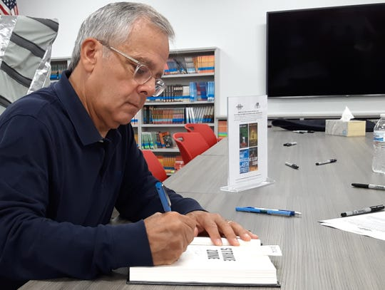 "Best-selling author Mike Lupica signs a copy of his new book ""Strike Zone"" for a student at Pilgrim Park Middle School in Elm Grove Friday, Sept. 13, 2019. Lupica visited with students for about an hour prior to the signing."