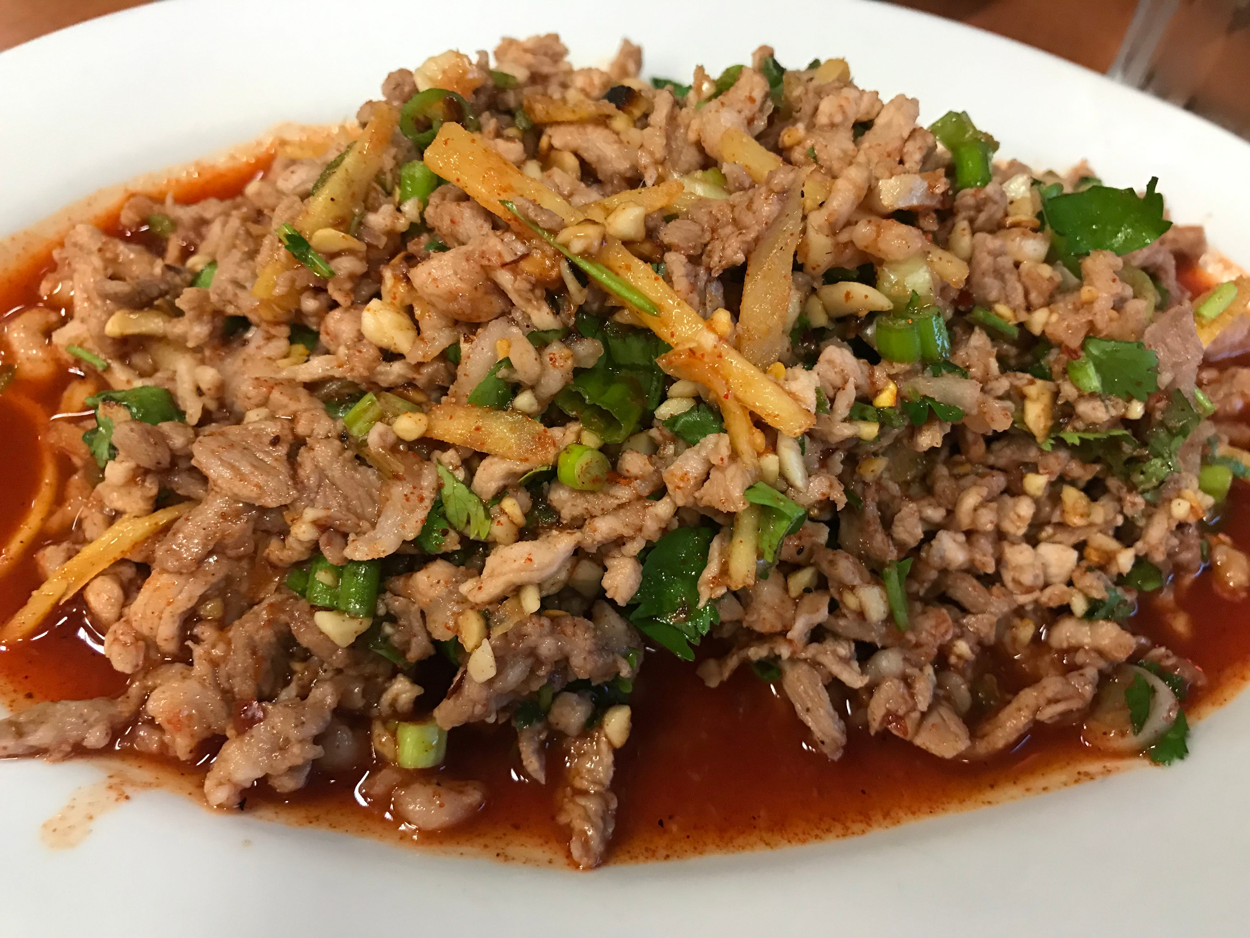 Nam sod, Thai pork salad, is flavored with ginger, green onions and cilantro, and gets crunch from peanuts. The dish, which can be ordered with chicken instead, is an appetizer at Kim's Thai, 938 W. Layton Ave.