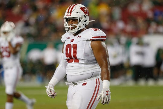 Wisconsin nose tackle Bryson Williams is out with an injury to his left leg.