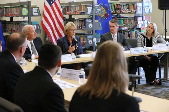 U.S. Secretary of Education Betsy DeVos, center, takes part in a roundtable with a group of stakeholders in the school choice program in Wisconsin. Shown  are state Senate Majority Leader Scott Fitzgerald, facing at left, St. Marcus  Superintendent Henry Tyson, second from right, and Principal Erin Johnson, right.