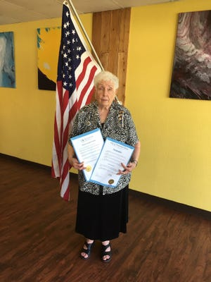 JoBelleZimmerman holds proclamations signed by Mountain Home MayorHillrey Adams and Baxter County JudgeMickey Pendergrass asking citizens to reaffirm the ideals of the Framers of the Constitution.Zimmerman, a member of the Captain Nathan Watkins Chapter of the Daughters of the American Revolution, recently presented a program on the observance of Constitution Week.This annual observance was initiated by the DAR in 1955, passed Congress and was signed into Public Law #915 in 1956. This historical event helped to inform people that the Constitution is the basis of America's great heritage and the foundation of our way of life.